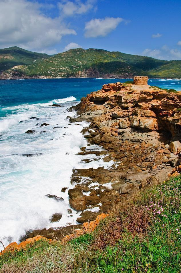 The waves and cliffs at Porto Ferro