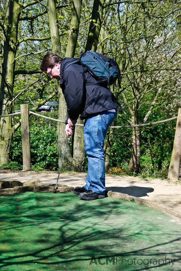 Andrew plays mini-golf