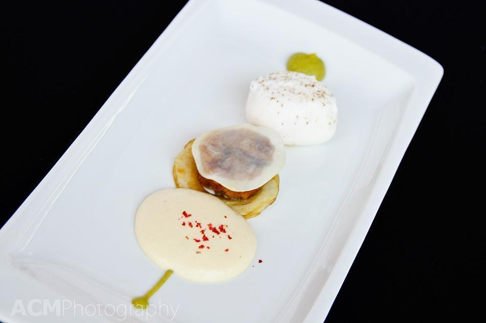 veal tail, a poached egg and a foam of smoked potatoes