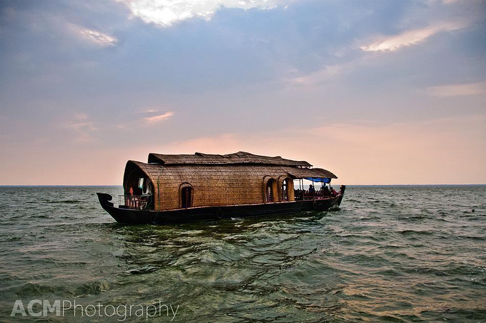 Traditional Kerala houseboat or kettuvallam at sunset