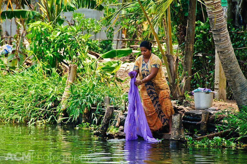 A Keralan woman does laundry in the backwaters