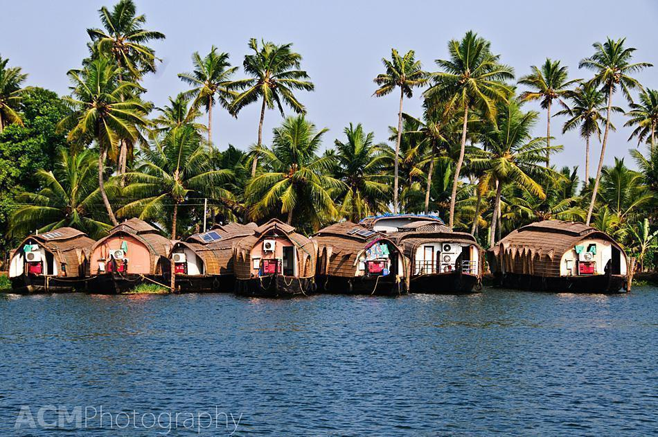 Families still live on the Kettuvallam houseboats in Kerala.