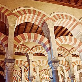 The iconic arches and columns of the Mezquita, Cordoba, Spain