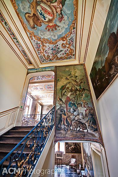 Paintings adorn the ceilings and walls of the staircase