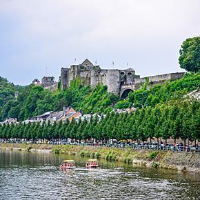 The Chateau de Bouillon towers over the River