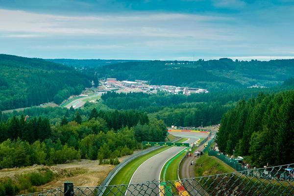The Spa-Francorchamps circuit winds through the green forest of the Belgian Ardennes.