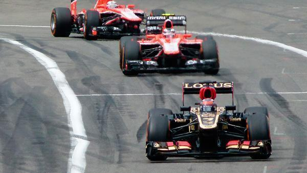 Drivers race in the first lap of the 2013 Belgian Grand Prix.