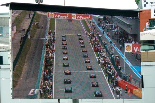 Large screens show the starting pole positions at the 2013 Belgian Grand Prix.
