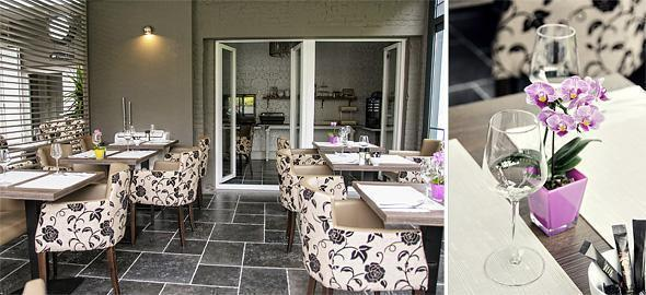 The bright newly added breakfast room offers a view of the garden