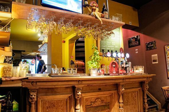 The beautiful carved wooden bar is home to more than 50 Belgian beer.