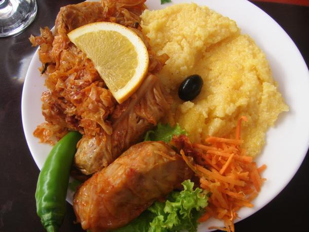 A plate of Romanian food: Sarma and Mamaliga.