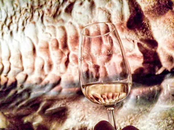 Taste wine deep underground at Grotte de Saint Marcel d'Ardeche