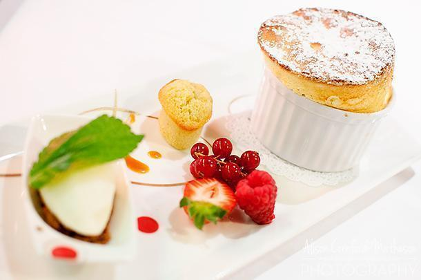 Lemon soufflé with ice-cream and red fruits.