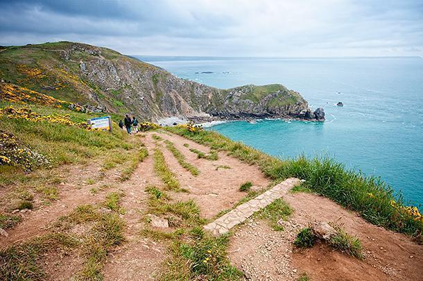 Hikers take off from the point to explore the dramatic cliffs of Manche
