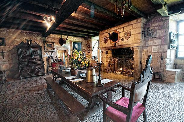 The formal dining room centres around the fire