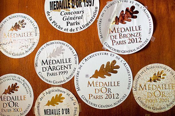 The distilleries numerous awards decorate the tasting room