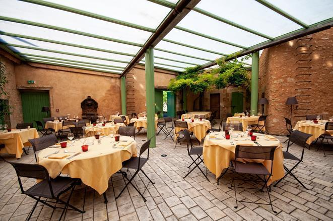 What better location for the dining-room than in the greenhouse.
