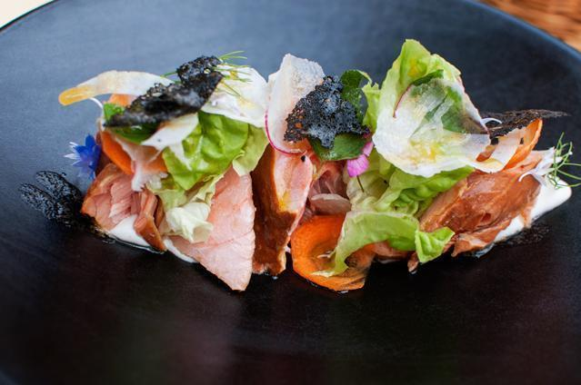 House-made hot smoked salmon with bio vegetables and edible flowers.
