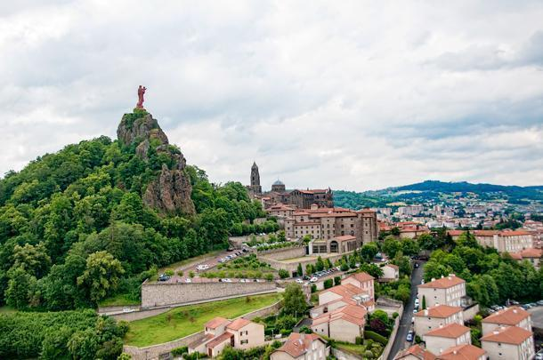 Cathédrale de Notre-Dame du Puy is nestled amongst the volcanic hills