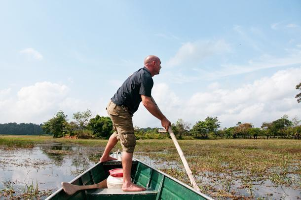 When the going gets rough, our naturalist guide, Stephane, powers our boat the old-fashioned way