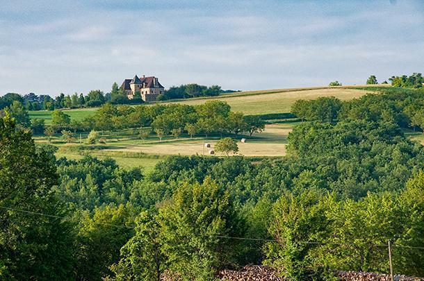 We pass through the rolling hills and fields of Dordogne