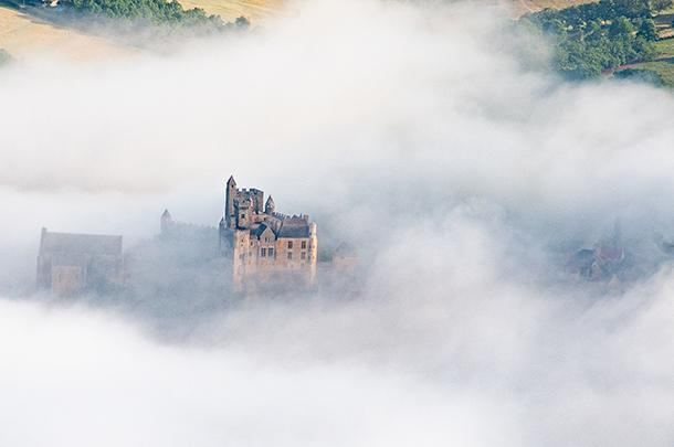 Breathtaking Beynac Castle seems to hover in the mists of the Dordogne