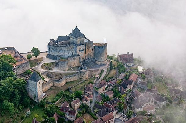 The Chateau de Castelnaud looks like a Disney version of a fairy tale, Dordogne, France