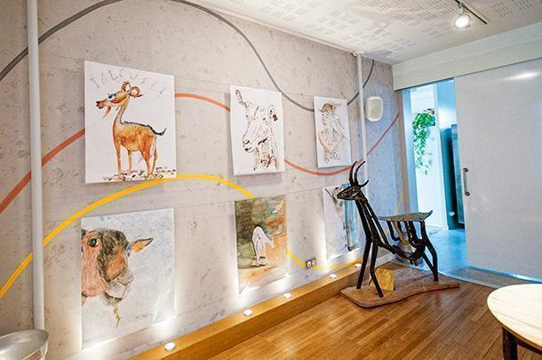 Goat-themed art sets the scene in the cheese tasting room