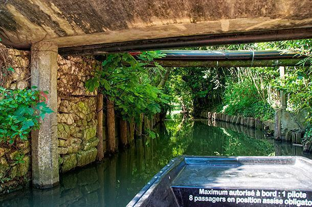 Watch your head, low bridges keep big boats out of the Marais Poitevin