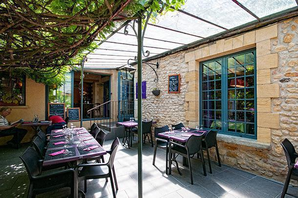A shady terrace beckons at Au Bon Accueil B&B and Restaurant, Limeuil