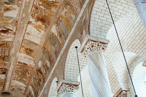 The painted columns lead your eye to the incredible frescoes