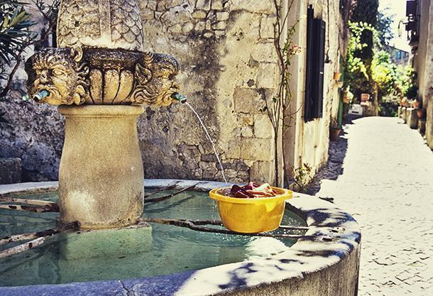 I loved the ancient water fountain in Séguret. A villager was even doing her washing here.