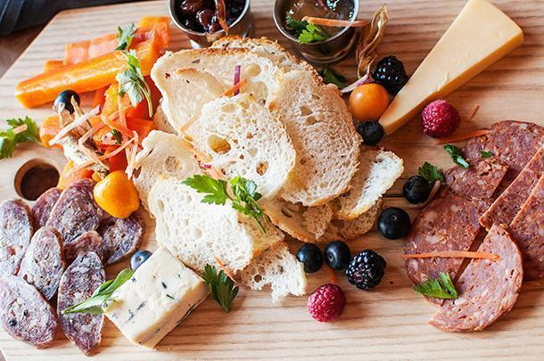 Now THAT is a cheese board - house-made and local cheese, charcuterie, fruit, and more