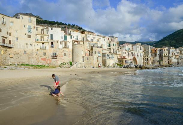 Playing on the beach in Cefalu