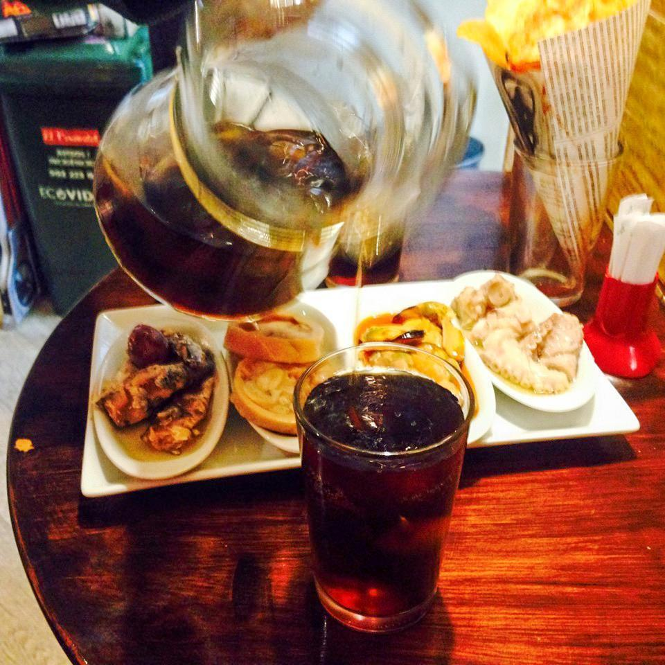 Enjoying a snack and Vermut, in Barcelona, Spain