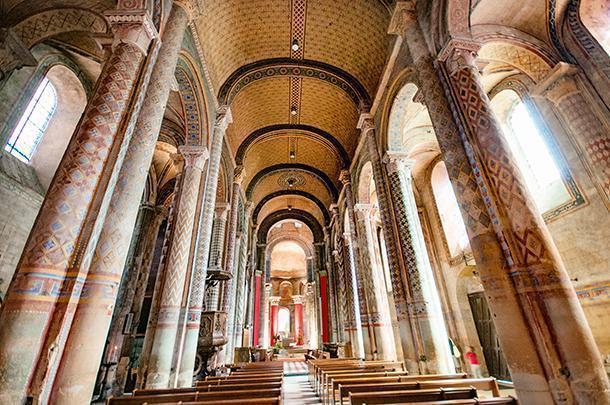 Inside the colourful Church of Notre-Dame la Grande, Poitiers