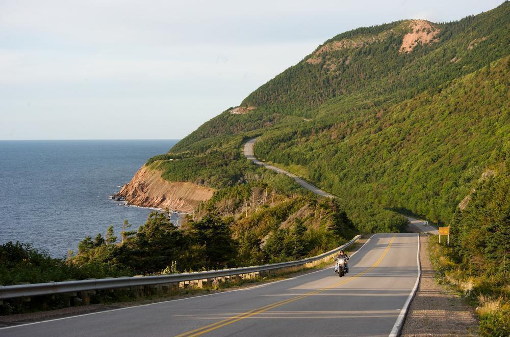 Motorcycles travel along the Cabot Trail in Cape Breton Highlands National Park near Cheticamp (Photo courtesy Brand Canada)