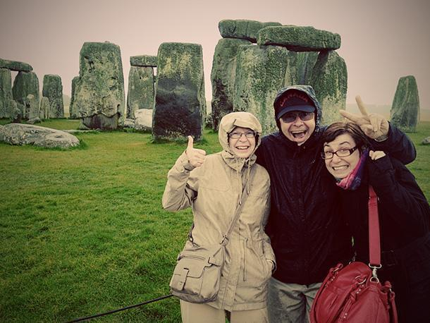 Smiling even during a downpour at Stonehenge