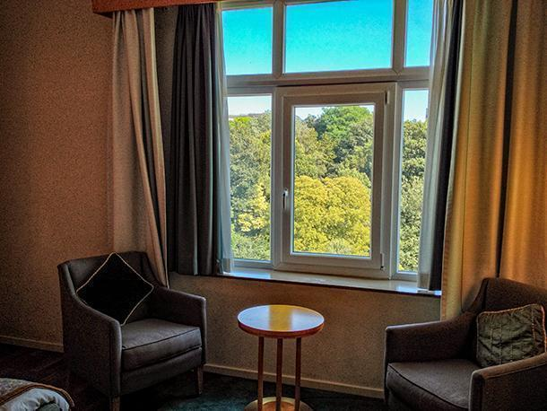 Hotel room with a view over Brussels' pretty green spaces.