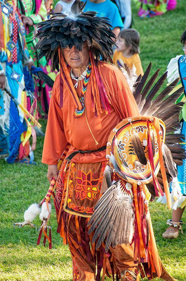A men's traditional dancer sporting plenty of eagle feathers at the Saint Mary's Powwow in Fredericton, NB