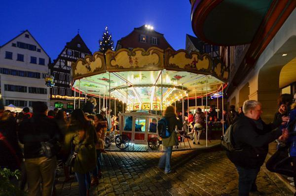 Take a ride on the historic carousel at Tübingen Weihnachtsmarkt
