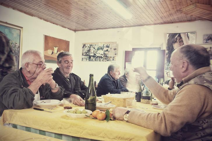 Dining with my new friends, the Tuscan hunters, in Castelfalfi, Italy