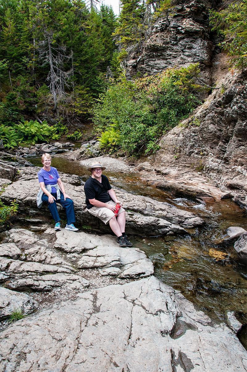 Mom and Andrew relax above Laverty Falls