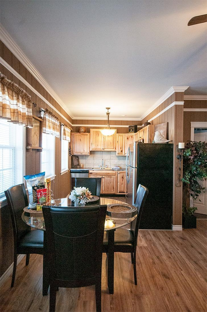 The open kitchen and dining area is filled with light at Eagle's Eye View Cottages