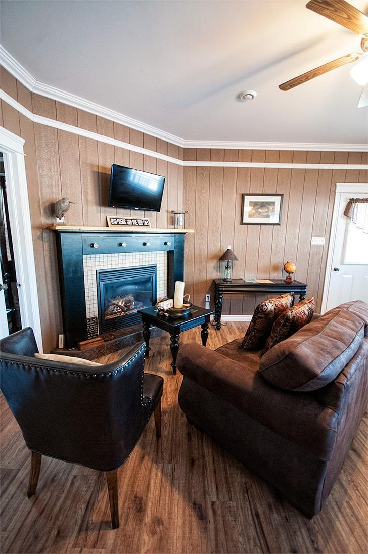 The cosy living room is the perfect place to relax at Eagle's Eye View Cottages on the Kingston Peninsula