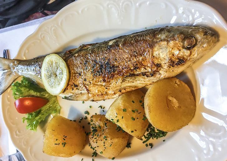 Fera fish dinner at Gasthof Weisses Lamm restaurant in Hallstatt, Austria