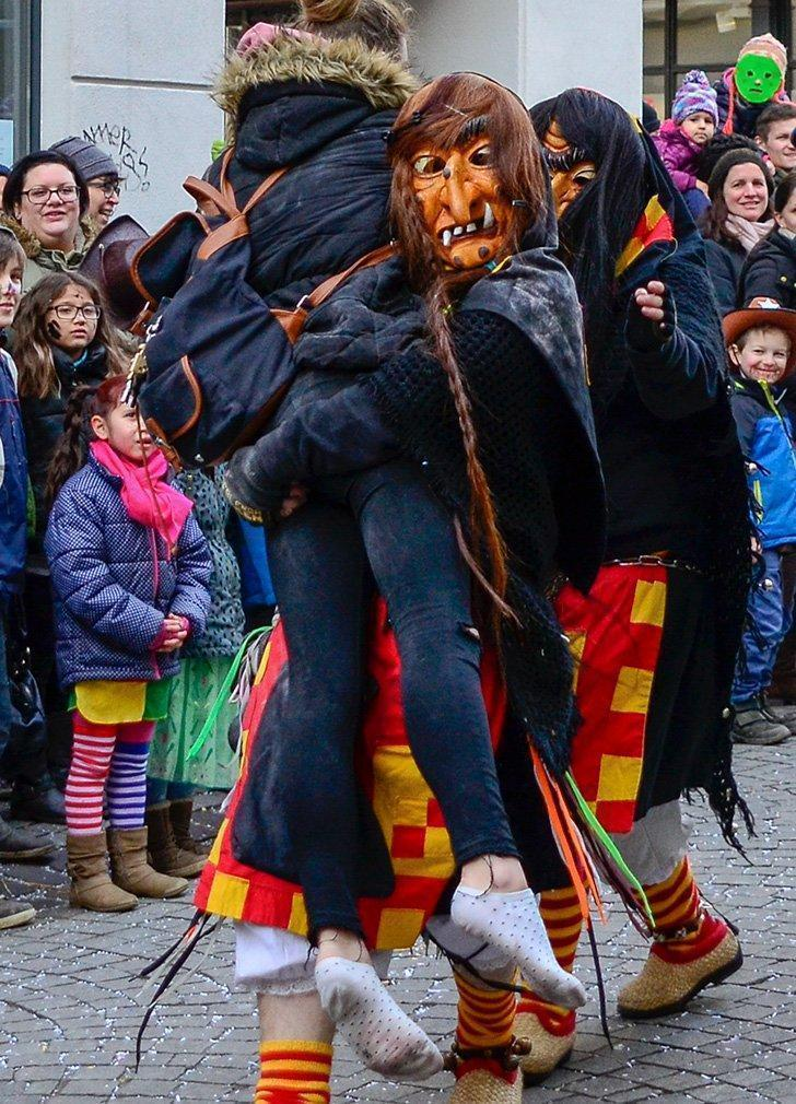 By standers sometimes get carried off by participants in the Fasching Parades