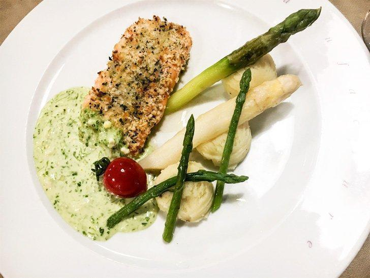 Herb-crusted salmon escalope served with potato mash and asparagus at La Manufacture restaurant