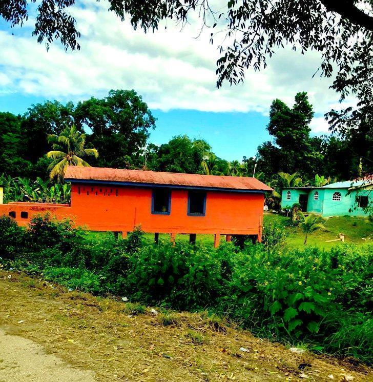 Brightly coloured houses on stilts in Belize.