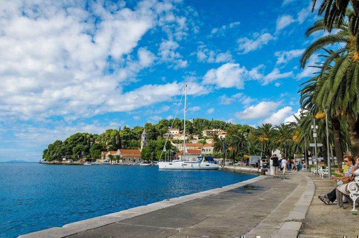 Stroll along the harbourfront in Cavtat, Croatia